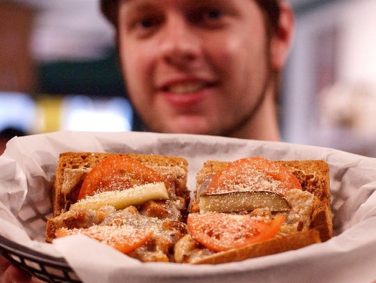 Kody Shusher, a worker at Cheba Hut sandwich shop in