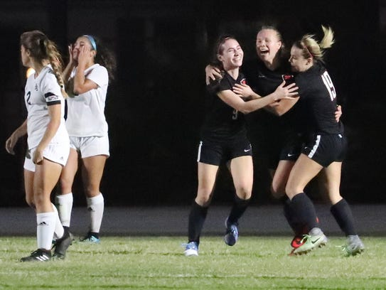 North Fort Myers' Emilee Hauser(center)  is celebrated