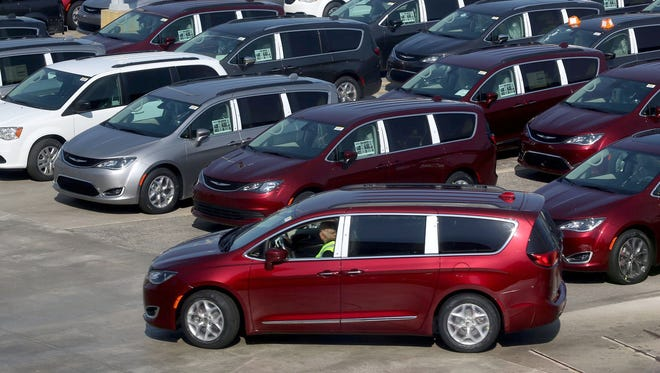 A fleet of 2017 Chrysler Pacifica are in a parking area at the FCA Windsor Assembly Plant in Windsor, Ontario in May 2016.