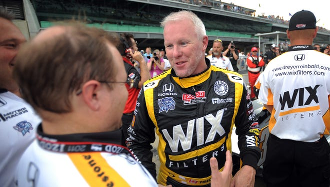 FILE - Drreyer & Reinbold Racing's Paul Tracy was all smiles  after his qualifying for run the Indianapolis 500, May 22, 2011,  at the Indianapolis Motor Speedway.