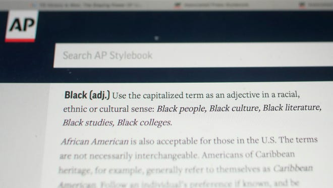 """The entry for the word """"Black"""" is shown in the online version of the AP Stylebook. The Associated Press changed its writing style guide to capitalize the """"b"""" in the term Black when referring to people in a racial, ethnic or cultural context, joining a growing number of news organizations making the change."""