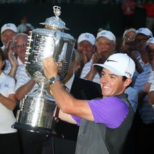 PGA golfer Rory McIlroy poses with the Wanamaker Trophy after winning the 2014 PGA Championship at Valhalla Golf Club.