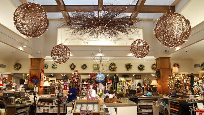 Kittelberger Florist & Gifts in Webster starts adding Christmas season decorations in October in preparation for holiday shopping.