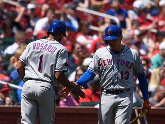 New York Mets shortstop Amed Rosario (1) is congratulated