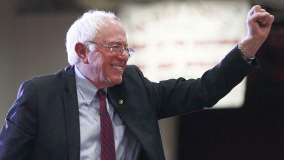 Bernie Sanders, smiling for once.