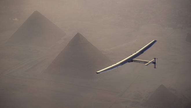 Solar Impulse 2, the solar powered plane, piloted by Swiss pioneer Andre Borschberg, is seen during the flyover of the pyramids of Giza on July 13, 2016 prior to landing in Cairo. The 16th leg of the round-the-world-trip from Seville in Spain covered a distance of 2,299 miles and took almost 49 hours.