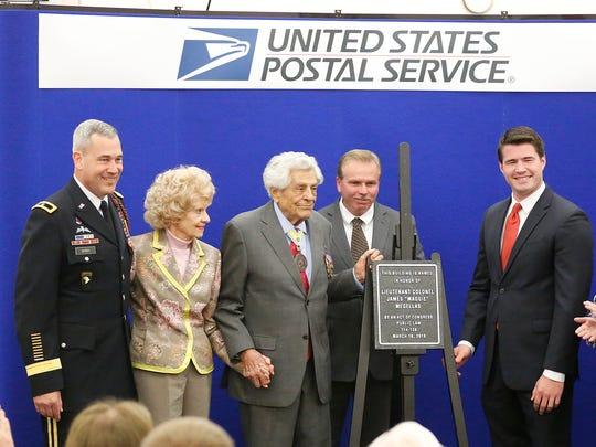 The Fond du Lac post office is now called the Lieutenant Colonel James 'Maggie' Megellas Post Office after a dedication ceremony at the office June 14. From left to right are Gen. Brian E. Winski; Carol Megellas, James' wife; Lt. Col. James Megellas; Alexander Omhof; and Jason Church, regional director for Sen. Ron Johnson.