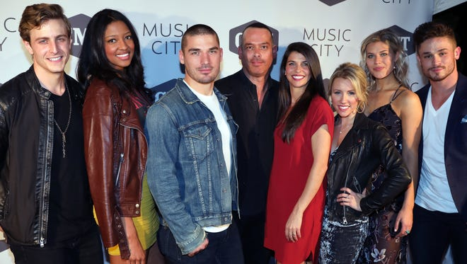 "Adam DiVello, creator and executive producer poses with the cast on the red carpet for the premiere of CMT's new TV show ""Music City"" February 20, 2018 at the Back Corner."