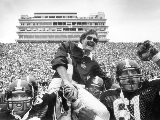 Former Iowa coach Hayden Fry is  carried off the field after a 1981 victory that helped Iowa to its first Rose Bowl appearance since 1959.