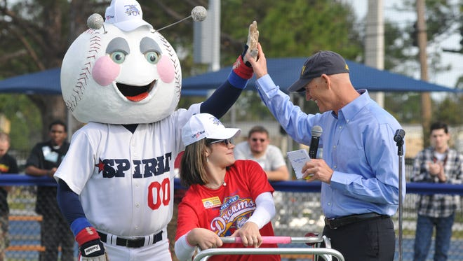 Then-Gov. Rick Scott (right) greets Brittany Klenotich, who has cerebral palsy, and The Bug during the January 2016 opening ceremony at Space Coast Field of Dreams in West Melbourne.