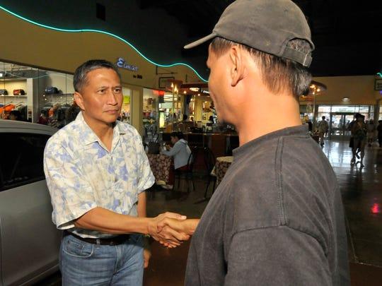 Former Lt. Gov. Mike Cruz shake hands with Benjamin