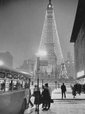 Under a  wintery blanket of snow, Downtown Merchants Association agreed to keep the lights on until 8 am one morning to allow downtown workers the opportunity to see the lights. Dec. 6, 1962