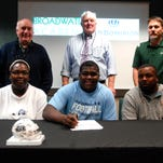 Broadwater senior Dontae Weatherly, bottom row second from left, poses after signing his letter of intent to play football at Old Dominion University Wednesday, Feb. 3, 2016. Also pictured, bottom row from left, Weatherly's mother Danielle, Weatherly, Weatherly's father David; second row from left, Headmaster Joe Spagnolo, Head Football Coach Noble Palmer and Athletic Director Ron Anson.
