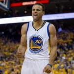 Stephen Curry reacts after scoring against the Oklahoma City Thunder during the second quarter in game five of the Western conference finals of the NBA Playoffs at Oracle Arena.