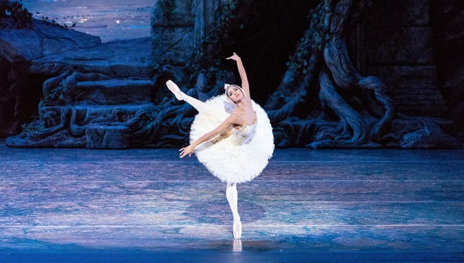 """Misty Copeland performs in """"Swan Lake,""""  at the Queensland Performing Arts Centre in Queensland, Australia. Copeland danced the lead role of Odette/Odile in """"Swan Lake"""", June 24, 2015, for the first time at American Ballet Theatre's home, the Metropolitan Opera House in New York."""