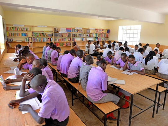 Student fill the Nobelity Project's recently completed library at Ol Moran Secondary School in Kenya.
