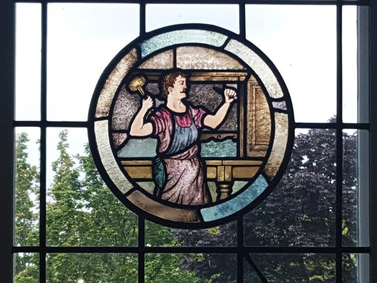 Stained-glass medallions that were formerly in the