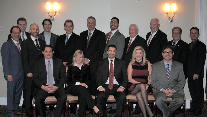 Standing (from left) are past president Tony Lifrieri; past president John Barnes; immediate past president Ian Ceppos; Jay Lapham; Paul Senecal; John Lomurno; Cameron Paktinat; 2016 President William Bassett; Vinny Finnegan; past president Mario Tarantino; and past president David Friedman. Seated (from left) are Edward Miller; Caroline Molloy; Scott Tangredi; Susan Curtis; and David Berk.