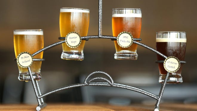 A complete flight shows off there newest beer as Heady Hollow Brewing Company opened in Fishers on Tuesday, August 26, 2015. Four house beers and a food menu are available at the first-ever Fishers brewery.