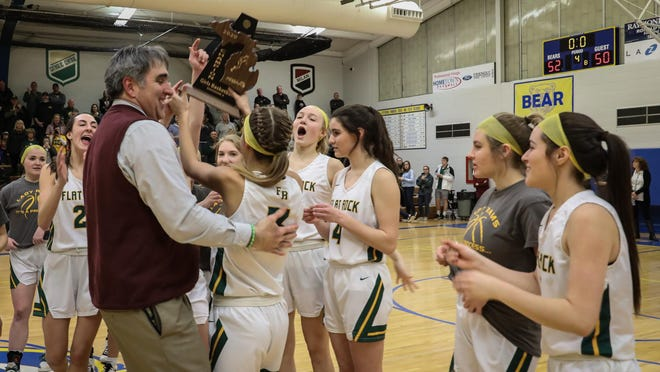 Marc Villemure celebrates with Flat Rock's girls basketball team after winning a District championship in March. Villemure is stepping down after 11 seasons as head coach of the Rams.
