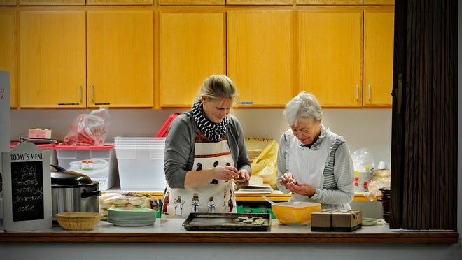 Susan Sandvig Shobe (left) and Audrey Jaeger form individual cookies called sandbakelsers Wednesday at Salem Lutheran Church in St. Cloud. The cookies will be featured in the church's 66th annual St. Lucia's Day Festival feast on Saturday.