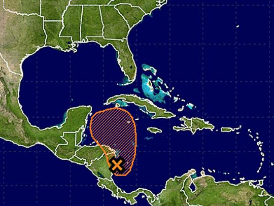 Weather disturbance in western Caribbean Sea could