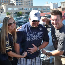 Tailgaters packed parking lots around the Edward Jones Dome before the Rams vs. Cowboys Game Sunday. Jessica Kenney, Christopher West, and Tyler Daniel.