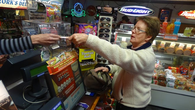 Denise Nowak, of Coshocton, bought Powerball tickets Monday afternoon in hopes of hitting the estimated $1.4 billion record jackpot in Wednesday's drawing.