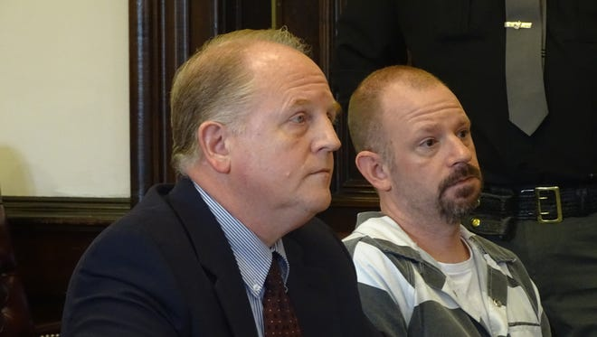 Kristopher S. McCombs, 40, right, of Brinkhaven, pleaded not guilty to felony charges of failure to stop after an accident and tampering with evidence. He appeared Monday in Coshocton County Common Pleas Court with his attorney, Public Defender Jeff Mullen, left.