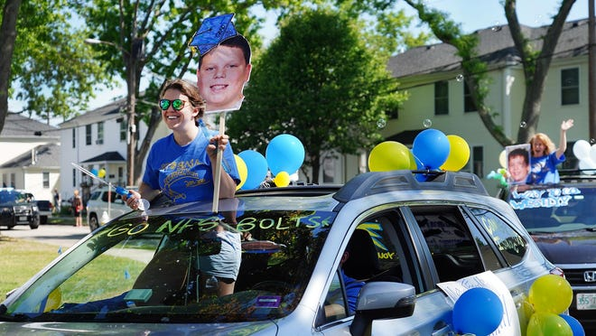The New Franklin Elementary School staff held a bus-led car parade through eight neighborhoods in Portsmouth on Thursday.