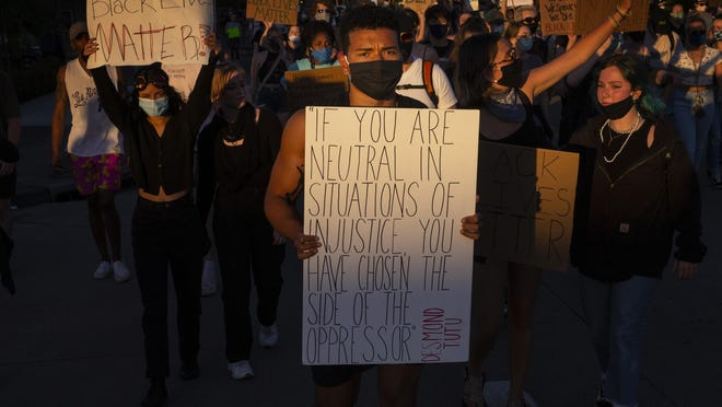 Spencer Smith, center, joins hundreds of other protesters in a march through the streets of Eugene memory George Floyd and others killed by police on June 3, 2020. [Chris Pietsch/The Register-Guard] - registerguard.com