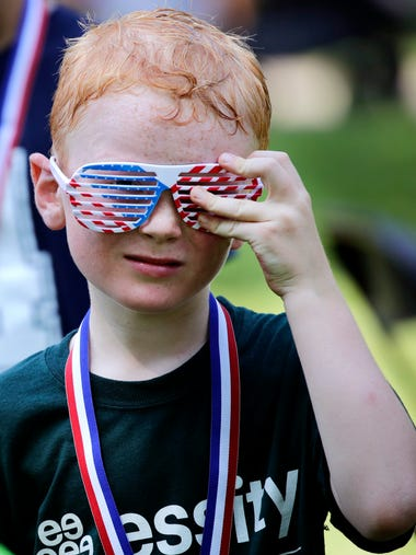Andrew Guif, 7, of Appleton, adjusts a pair of American