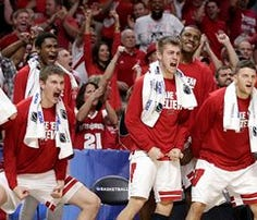 LOS ANGELES, CA - MARCH 26: Traevon Jackson #12 of the Wisconsin Badgers celebrates after the Badgers 79-72 victory against the North Carolina Tar Heels during the West Regional Semifinal of the 2015 NCAA Men's Basketball Tournament at Staples Center on March 26, 2015 in Los Angeles, California. (Photo by Harry How/Getty Images)
