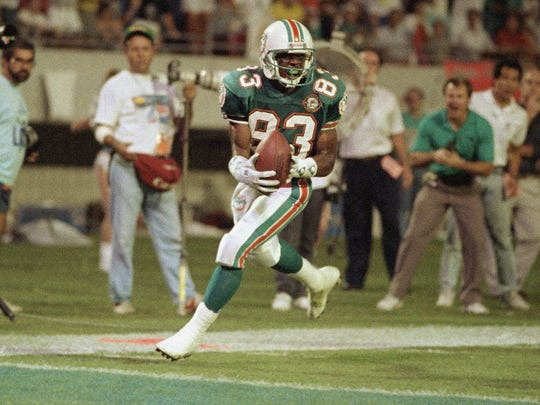 Mark Clayton scores a touchdown in a playoff game early in 1991.