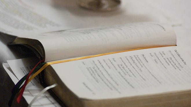 A Book of Common Prayer rests on the altar during a service of St. Paul's Anglican Church.
