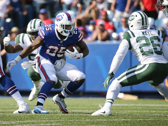 Bills running back LeSean McCoy looks to beat Jets
