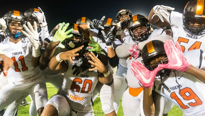 Woodrow Wilson celebrates a 30-20 win over Moorestown at Moorestown High School on Friday, October 6.
