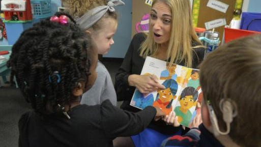 Sound Start program director and teacher Tracy Edenfield reads a book to her students at Sound Start, part of the Savannah Speech & Hearing Center.