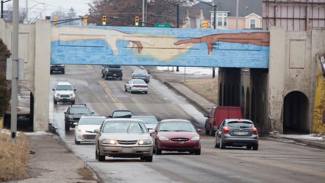 The Madison Street underpass was painted in 2003 with a mural depicting hands of various colors reaching toward each other. A project of the Mayor's Youth Council, the mural was intended to brighten a Muncie landmark and to depict and promote unity. Some people complained, however, about the racial implications of the mural's design, showing different colored fingers on the same hand.