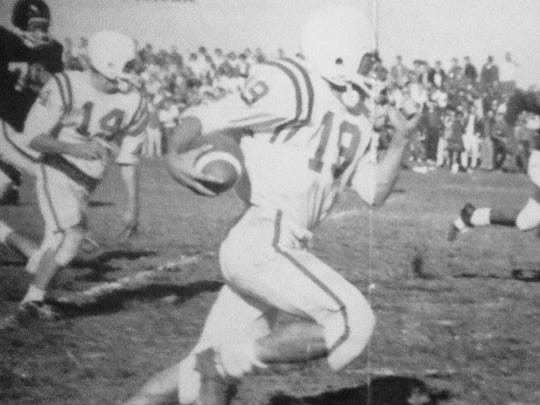 Running back Sam Riello rips off a big gain for the Brick Green Dragons during the 1961 season, their second straight undefeated campaign.
