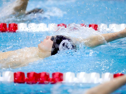 Central York's Jesse Tate swims the 200-yard IM in the 2013 PIAA District 3 AAA swim championships last March at Cumberland Valley.
