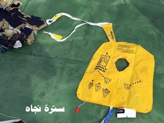 This picture posted Saturday, May 21, 2016, on the official Facebook page of the Egyptian Armed Forces spokesman shows a life vest from EgyptAir flight 804. Search crews found floating human remains, luggage and seats from the doomed EgyptAir jetliner Friday but face a potentially more complex task in locating bigger pieces of wreckage and the black boxes vital to determining why the plane plunged into the Mediterranean.
