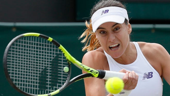 Romania's Sorana Cirstea returns to Spain's Garbine Muguruza during their Women's Singles Match on day six at the Wimbledon Tennis Championships in London Saturday, July 8, 2017. (AP Photo/Kirsty Wigglesworth)