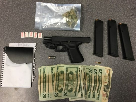 Police say they found guns, drugs, ammunition and cash