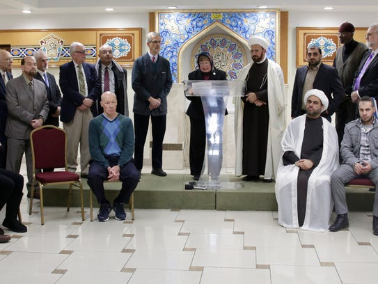 Members of the interfaith community assemble as Pastor