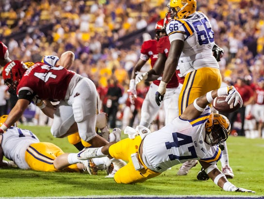 LSU Tigers fullback Bry'Kiethon Mouton (47) tries to