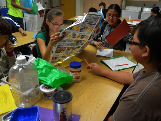 Students work on a project at Heart Butte High School.