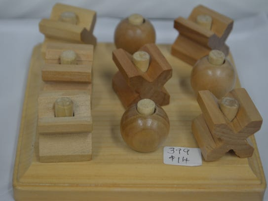 Wooden version of Tic-Tac-Toe by Mike Asberry