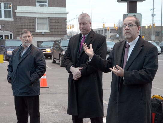 Battle Creek Mayor Dave Walters, right, unveils a new