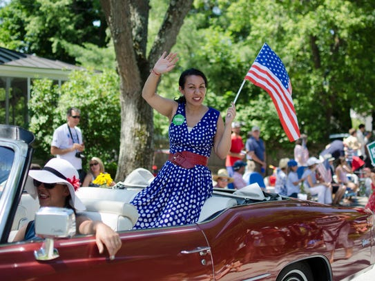 Kesha Ram waves to the crowd on July 4, 2016 in Bristol